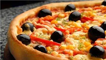 На фото вкусная пицца, которую вы можете заказать в Казани